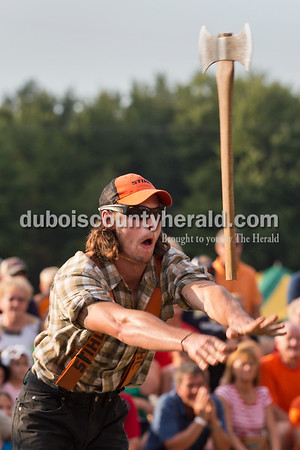 Professional lumberjack Tyler Alden of Frederic, Wis. threw an axe at a target during the Olympics of the Forest show at the Ireland Bicentennial celebration on Saturday. Sarah Ann Jump/The Herald