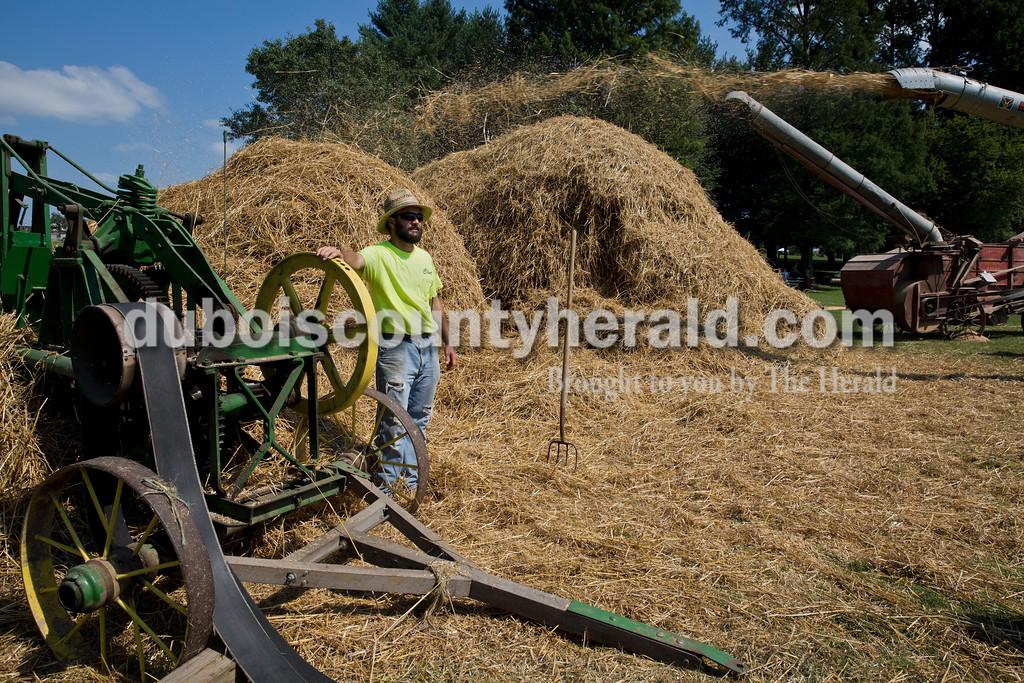 Clint Renner of Ireland stood near an antique hay baler as a wheat thresher ran nearby during the Ireland Bicentennial celebration on Saturday. Sarah Ann Jump/The Herald