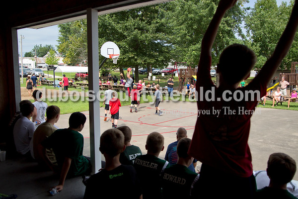 Sarah Shaw/The Herald A crowd gathered to watch the 3-on-3 basketball tournament during the town of Birdseye's annual picnic at Birdseye Park on Saturday.