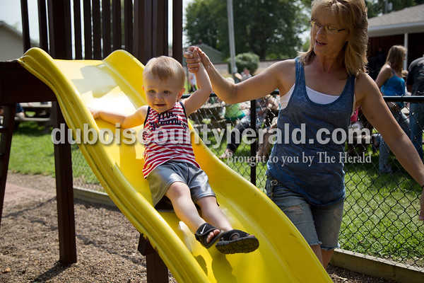 Sarah Shaw/The Herald Karen Andry of Birdseye helped her grandson Levi Leonard of Birdseye, 1, down the slide during the town of Birdseye's annual picnic at Birdseye Park on Saturday.