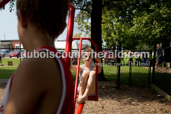 Sarah Shaw/The Herald Jazzy Marcum of Tell City, 10, right, balanced on the seesaw with her brother Solomon, 11, during the town of Birdseye's annual picnic at Birdseye Park on Saturday.