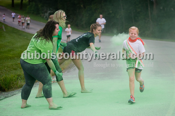 Little Miss Ireland Bicentennial Andyn Lampert of Ireland, 8, ran through a cloud of colored cornstarch during the Color Me Crazy 5k at the Ireland Bicentennial celebration on Saturday. Sarah Ann Jump/The Herald