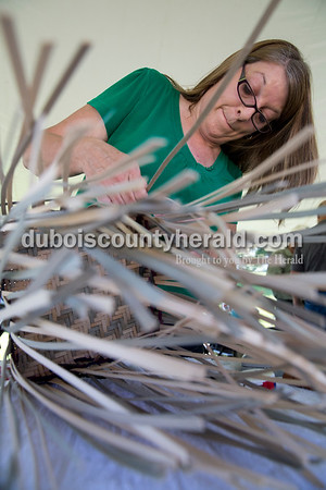 Joni Dillon of Ireland weaved a basket as part of the heirloom demonstrations during the Ireland Bicentennial celebration on Saturday. She learned the craft with her daughter through Girl Scouts eight years ago. Sarah Ann Jump/The Herald