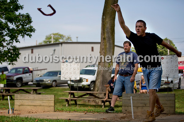 Sarah Shaw/The Herald Kevin Van Hoosier of Tell City, played horseshoes while Steve Underhill of St. Croix, left, waited his turn during the town of Birdseye's annual picnic at Birdseye Park on Saturday.