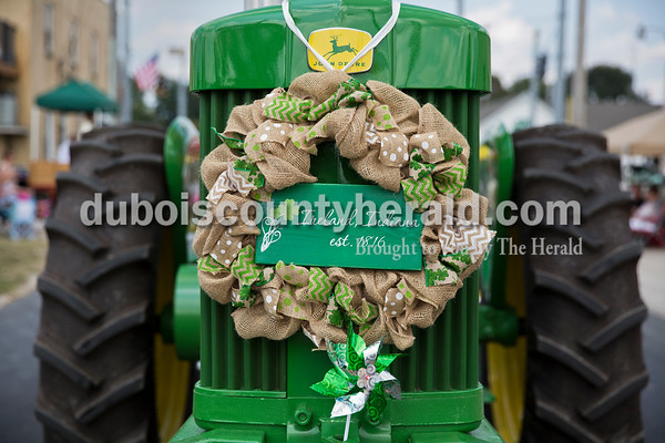 A tractor decorated with an Ireland wreath drove in the Ireland Bicentennial parade on Sunday. Sarah Ann Jump/The Herald