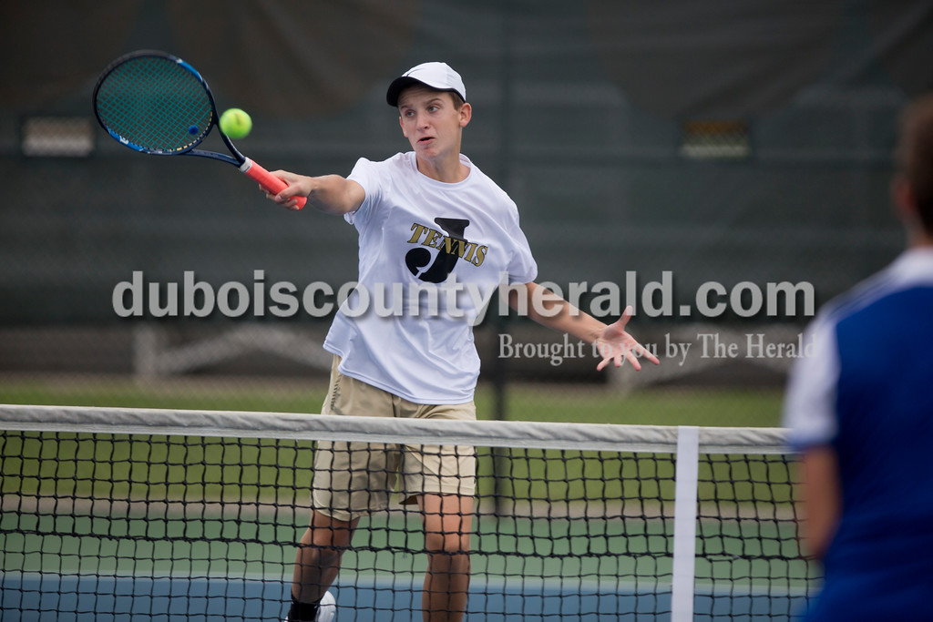 Sarah Shaw/The Herald<br /> Jasper's Noah Mendel volleyed the ball over the net during a doubles match against Castle at the tennis invitational in Jasper on Saturday.