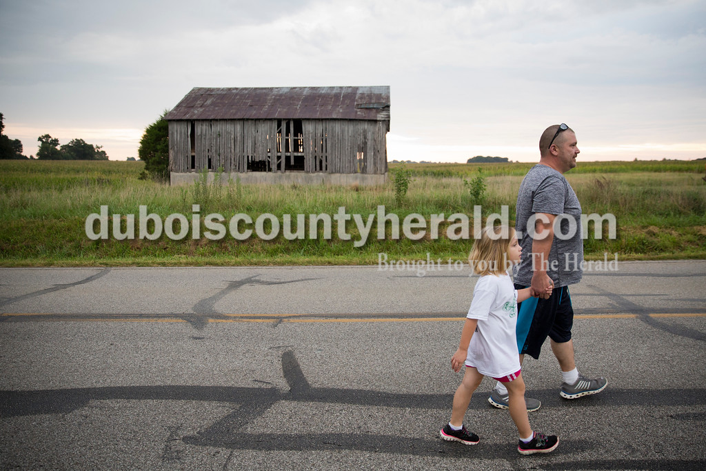 Clint Garland of Ireland and his daughter Dakota, 6, held hands as they walked in the Color Me Crazy 5k during the Ireland Bicentennial celebration on Saturday. Sarah Ann Jump/The Herald