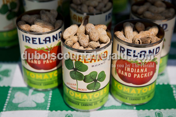 The Ireland Historical Society sold peanuts in keepsake cans decorated with labels based off original Shamrock Cannery canned tomatoes during the Ireland Bicentennial celebration on Saturday. The Shamrock Cannery was organized by a group of local farmers in 1939. Sarah Ann Jump/The Herald