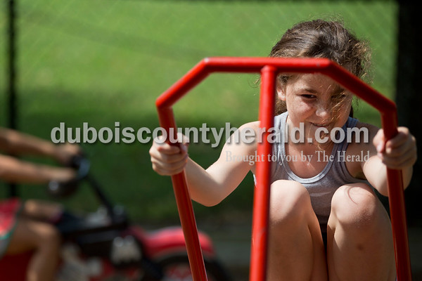 Sarah Shaw/The Herald Jazzy Marcum of Tell City, 10, played on the seesaw with her brother, Solomon, 11, during the town of Birdseye's annual picnic at Birdseye Park on Saturday.