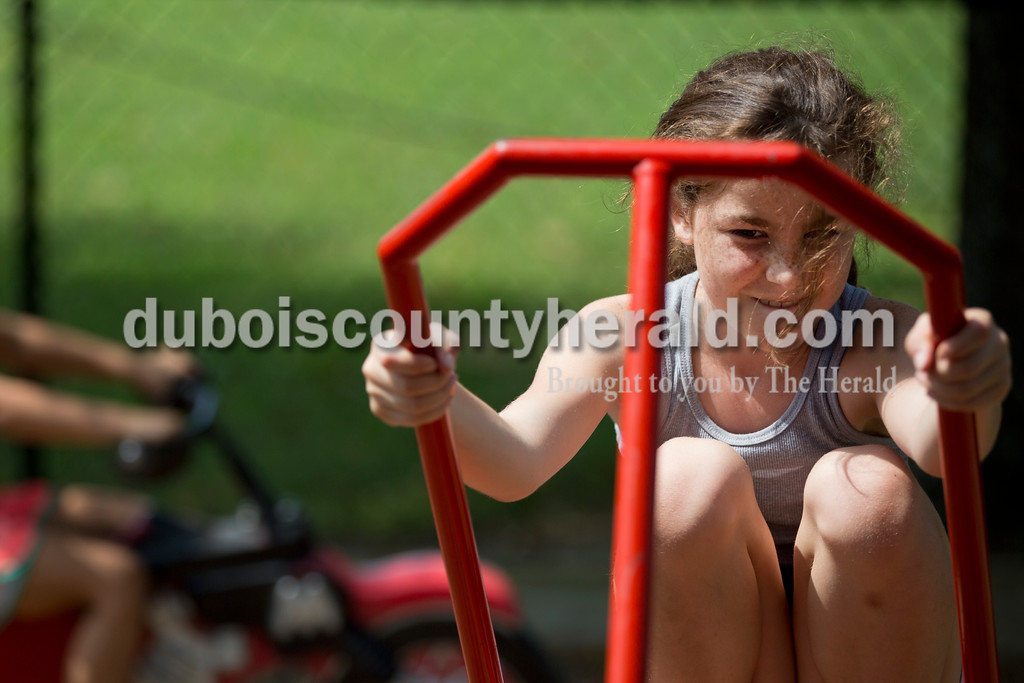 Sarah Shaw/The Herald<br /> Jazzy Marcum of Tell City, 10, played on the seesaw with her brother, Solomon, 11, during the town of Birdseye's annual picnic at Birdseye Park on Saturday.
