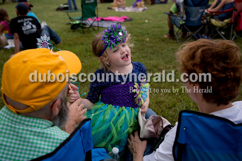 Sarah Shaw/The Herald<br /> Maggie Burch of Louisville, Ky., 4, talked with her grandparents Eddie andJoannie Burch of Dubois during the Ferdinand Folk Festival in Ferdinand on Saturday.