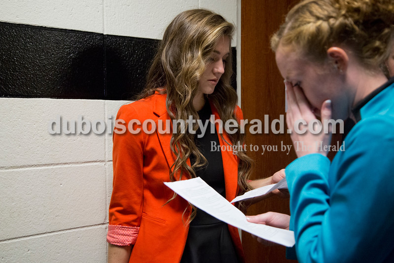 Sarah Shaw/The Herald<br /> Lauren Meyer, 17, and Emily Eckert, 18, both of Huntingburg, read over the potential interview questions before the professional wear portion of the Miss Herbstfest pageant at Southridge High School in Huntingburg on Sunday. Meyer was named first runner-up.