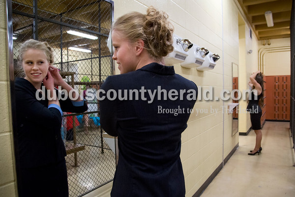 Sarah Shaw/The Herald Misty Merter of Huntingburg, 17, fixed her hair in the locker room before the start of the Miss Herbstfest pageant at Southridge High School in Huntingburg on Sunday.