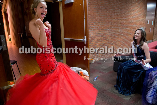 Sarah Shaw/The Herald Bailey Barrett of Huntingburg, 18, twirled while 2015 Miss Herbstfest Erica Buechlein of Huntingburg, 18, right, cheered while waiting for the judges' decision during the pageant at Southridge High School in Huntingburg on Sunday.