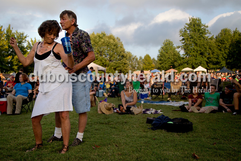 "Sarah Shaw/The Herald<br /> Terri Damron of Ashville, Ky., danced with her husband, Walter, during the Ferdinand Folk Festival in Ferdinand on Saturday. ""He's my husband of 40 years,"" Terri said. ""God bless him!"""