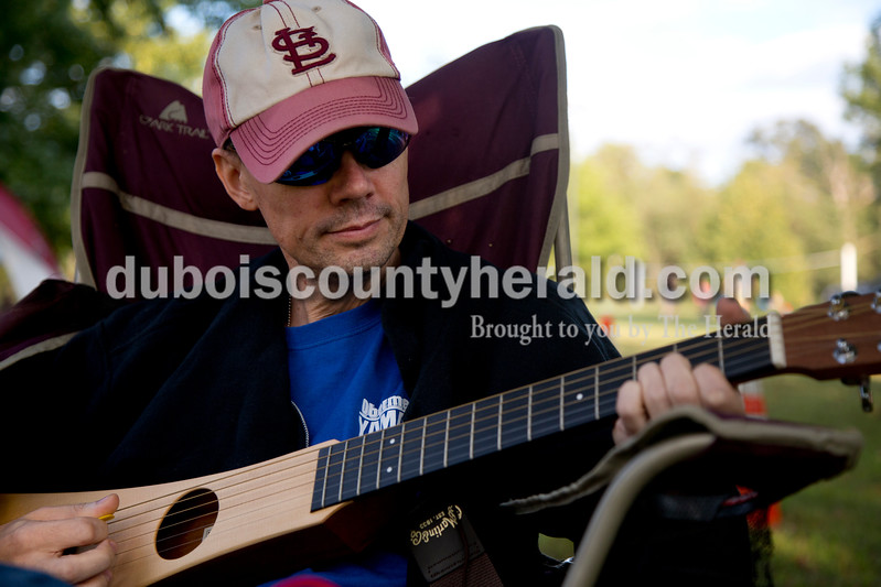 Sarah Shaw/The Herald<br /> Sonny Stawn of Loogoote, played a backpacker travel guitar during the Ferdinand Folk Festival in Ferdinand on Saturday.