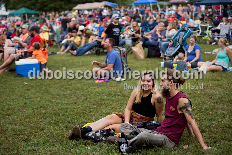 Sarah Shaw/The Herald<br /> Noelle May and Chris Ferguson, both of Greenwood, listened to a music performance during the Ferdinand Folk Festival in Ferdinand on Saturday.