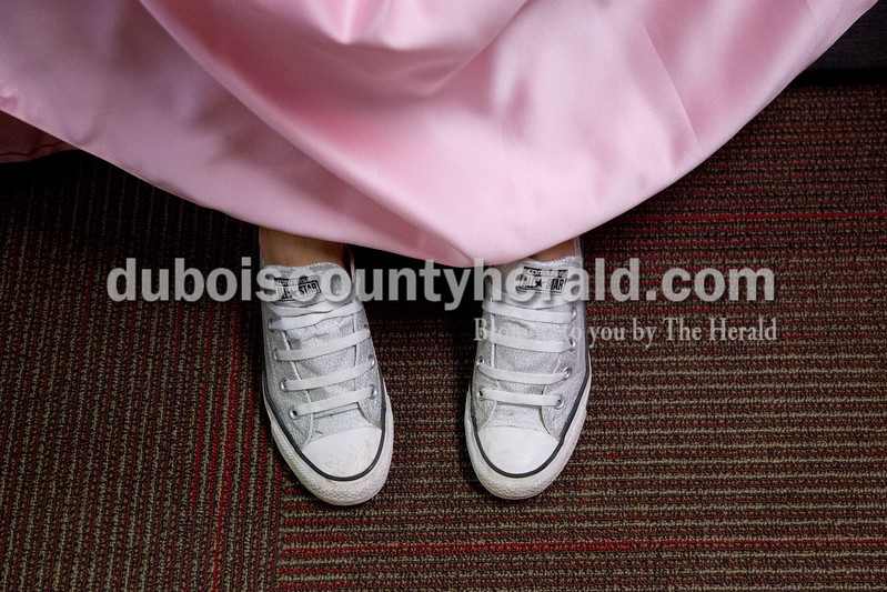 "Sarah Shaw/The Herald<br /> Jenna Brock of Huntingburg, 16, wore Converse sneakers with her formal dress during the pageant at Southridge High School in Huntingburg on Sunday. ""They're comfier than heels!"" she said."
