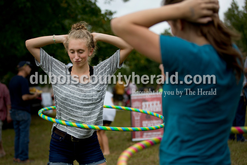 Sarah Shaw/The Herald<br /> Lydia Grow of Jasper, 14, left, hula hooped with her friend Leah Haas of Jasper, 13, during the Ferdinand Folk Festival in Ferdinand on Saturday.