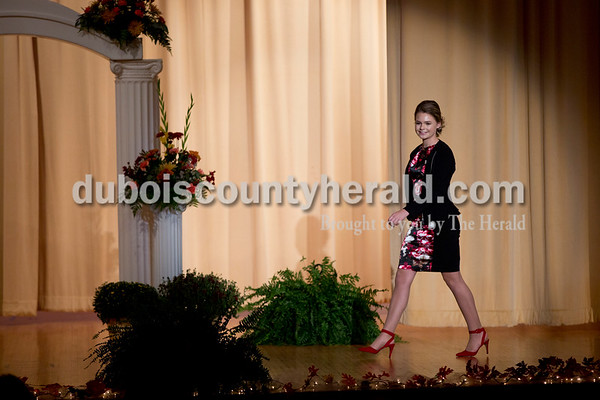 Sarah Shaw/The Herald Jenna Brock of Huntingburg, 16, modeled her professional wear during the Miss Herbstfest pageant at Southridge High School in Huntingburg on Sunday.