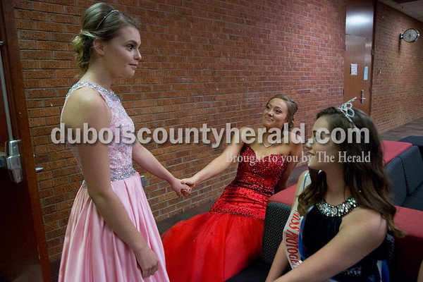 Sarah Shaw/The Herald Contestants Jenna Brock, 16, left, Bailey Barrett, 18, and 2015 Miss Herbstfest Erica Buechlein, 18, all of Huntingburg, chatted while waiting for the judges' decision during the pageant at Southridge High School in Huntingburg on Sunday. Barrett was crowned 2016 Miss Herbstfest.