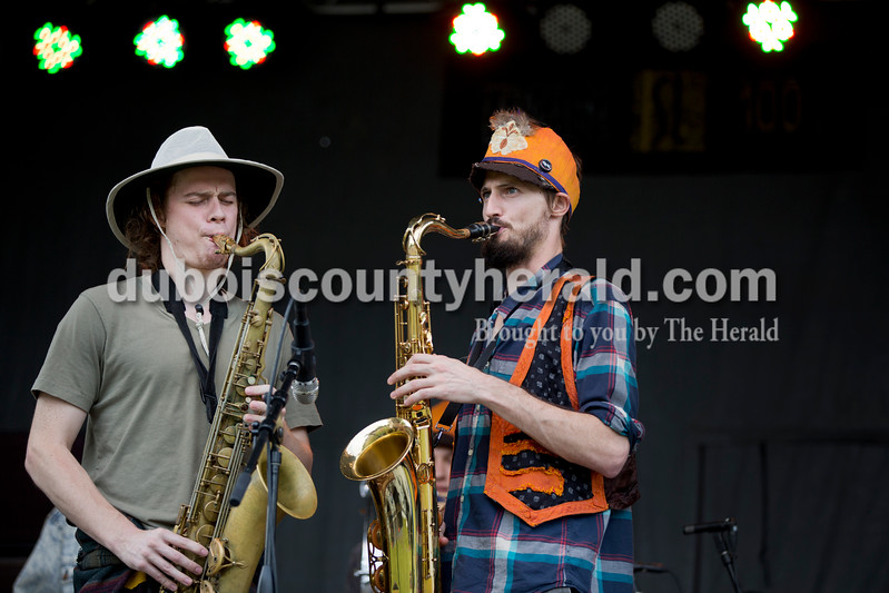 Sarah Shaw/The Herald<br /> Eric Arnold and Dylan Maloney, both of Bloomington, performed with the Jefferson Street Parade Band during the Ferdinand Folk Festival in Ferdinand on Saturday.