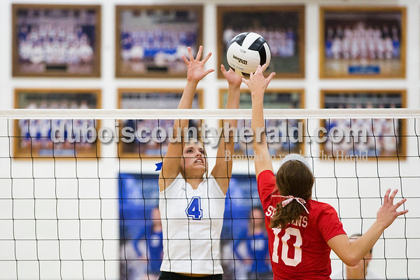 Northeast Dubois' Molly Lueken blocked a shot by South Knox's Morgan Engstrom during Tuesday's volleyball match in Dubois. Northeast Dubois defeated South Knox in 3 sets. Sarah Ann Jump/The Herald