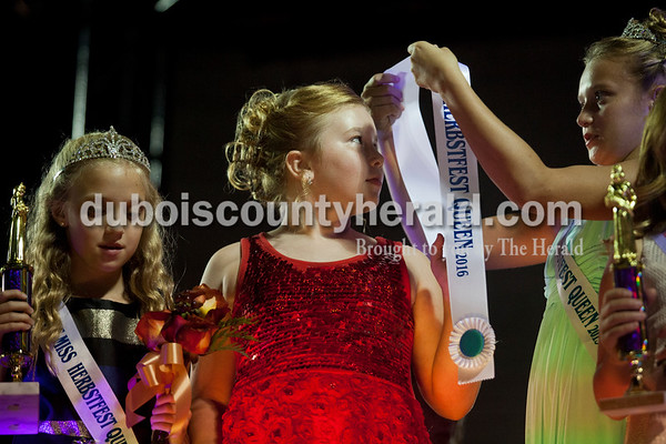 Amerynn Fetter of Huntingburg, 8, was awarded Junior Miss Herbstfest by last year's Junior Miss Arrington Hartke of Ireland, 11, right, and Alexis Eckert of Hutngburg, 8, left, during the Little Miss and Junior Miss Herbstfest pageant Friday night in Huntingburg.  Alisha Jucevic/The Herald