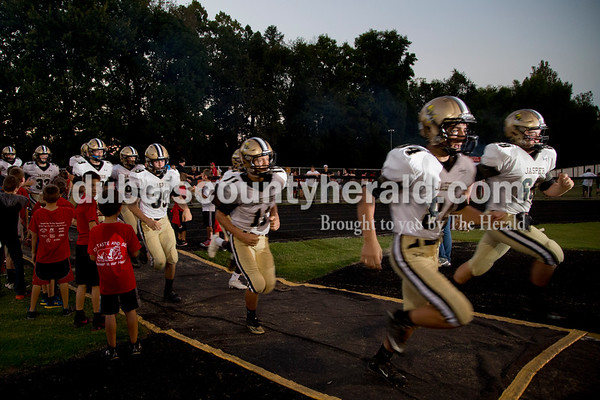Sarah Shaw/The Herald The Jasper Wildcats sprinted onto the field before the start of the game against Princeton Community High School in Princeton on Friday. Jasper won 35-28.