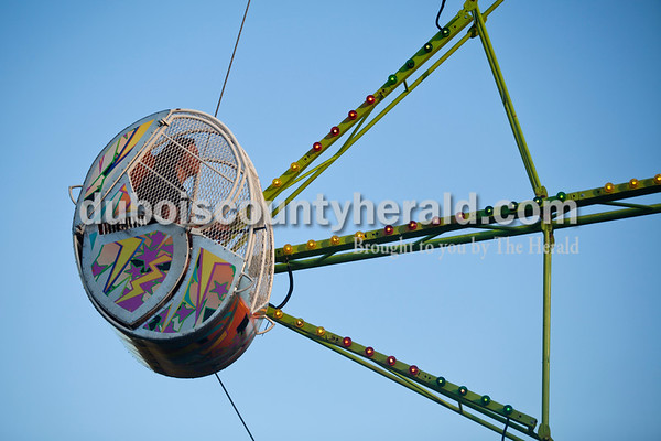 Shelby Phillips of Huntingburg, 13, circled around the Ferris Wheel during opening night of Herbstfest on Thursday night in Huntingburg City Park. The festival continues throughout the weekend.   Alisha Jucevic/The Herald