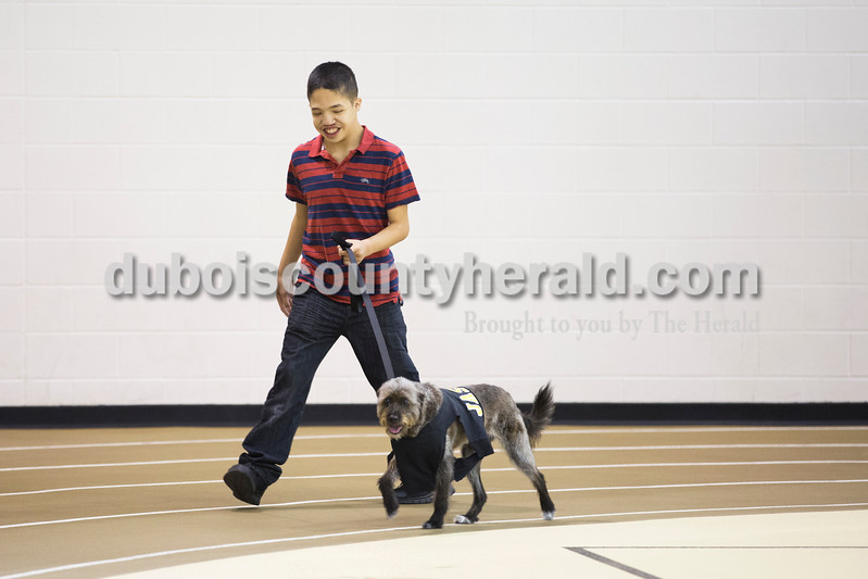 Sarah Ann Jump/The Herald<br /> Jasper High School junior Frank De La Cruz walked Serena, a comfort dog, at the school on Friday morning.