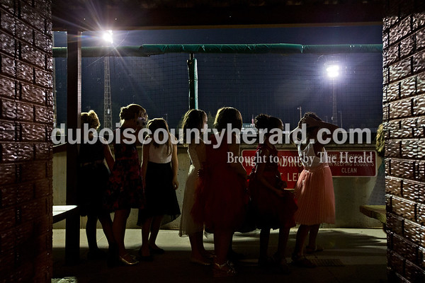 Little Miss contestants lined up in the League Stadium dugout during the Little Miss Herbstfest pageant Friday night in Huntingburg.  Alisha Jucevic/The Herald