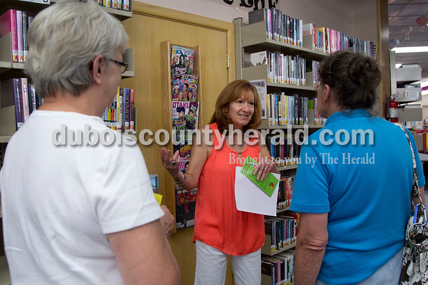 Sarah Shaw/The Herald Gaylene Laubscher of Jasper, center, talked with Judy Hubster and Sandra Hopf, both of Jasper, during the open house at the Jasper Public Library on Wednesday. Librarians showed patrons all the services that the library currently provides as well as problems that the current facility faces.