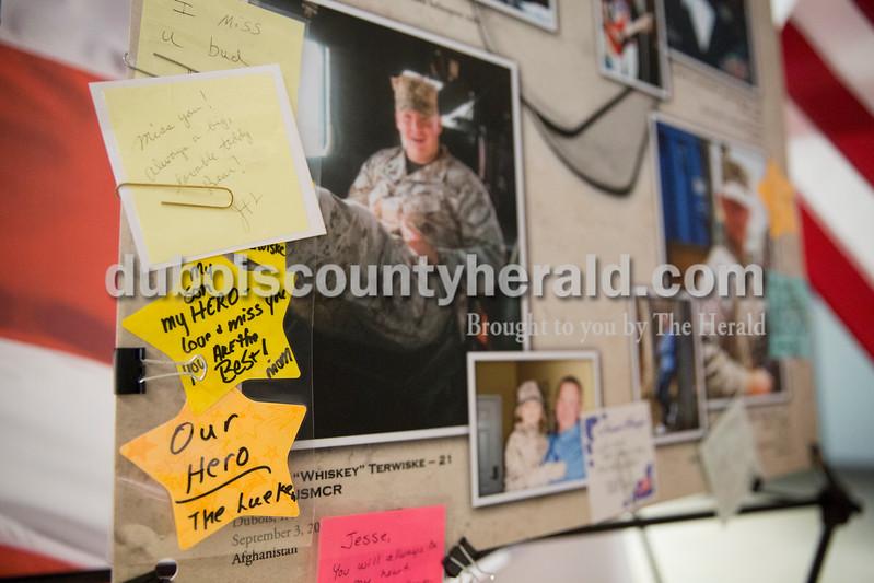 Sarah Ann Jump/The Herald<br /> Handwritten notes adorned the photo of Marine Lance Cpl. Alec Terwiske of Dubois, who died in Afghanistan in 2012, in the Remembering Our Fallen touring photo display at the Jasper National Guard Armory on Wednesday.