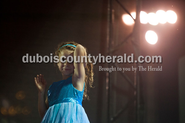 Abigail Flamion of Huntingburg, 6, waved to the crowd during the Little Miss Herbstfest pageant Friday night in Huntingburg.  Alisha Jucevic/The Herald