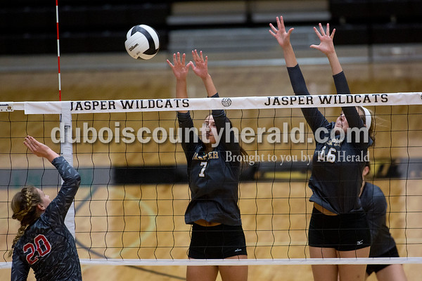 Sarah Shaw/The Herald Jasper's Alexa Stenftenagel and Riley Merder defended while Southridge's Amanda Brewer hit the ball over the net during the game in Jasper on Thursday. Jasper won 3-0.