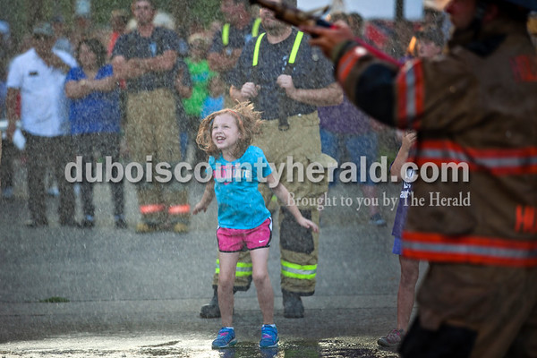 Kali Chambers of Holland, 7, cheered on her father, Chief of the Holland Volunteer Fire Department, Adam Chambers during Herbstfest on Friday night in Huntingburg.  Alisha Jucevic/The Herald