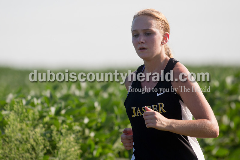 Sarah Shaw/The Herald<br /> Jasper's Noelle Weyer ran during the Tri-County Invitational cross country meet at Southridge High School in Huntingburg on Tuesday.