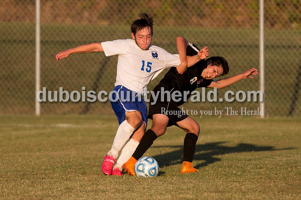Northeast Dubois' Tristen Myers and Southridge's Jonathan Escobar fought for possession of the ball during Thursday evening's game in Dubois. Northeast Dubois defeated Southridge 4-3. Sarah Ann Jump/The Herald
