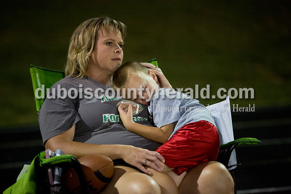 Kim Beck of Ferdinand watched the game as her son Bryson, 4, slept during Friday evening's game in Ferdinand. North Posey defeated Forest Park 34-0. Sarah Ann Jump/The Herald