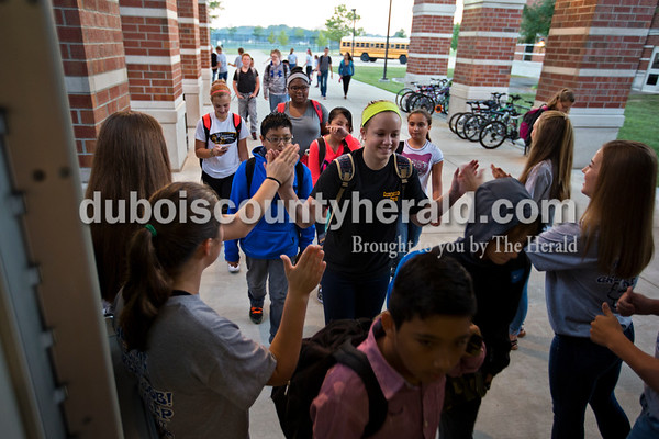 """Jasper Middle School seventh-grader Lily Jones high-fived ROOS club students as she walked into Jasper Middle School on Thursday morning. This is the third year for the weekly Thumbs up Thursdays event, put on by the ROOS club, Respecting Ourselves and Other Students. """"I wanted to do something that would take an ordinary day, and make it extra special,"""" said JMS teacher Jill Wigand. """"It's just an extra day for the students and staff to tell the kids that they're doing a great job, and to keep it up.""""  Alisha Jucevic/The Herald"""