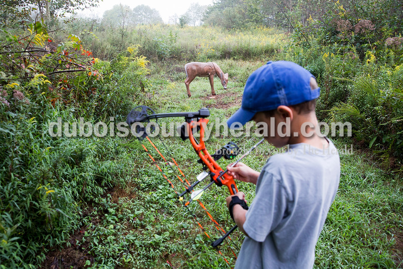 Sam Beck of Celestine, 7, loaded an arrow in his compound bow before taking aim at a deer target from a distance of 10 yards during the 3D target shoot hosted by Patoka Lake Bowhunters at Patoka Lake Archery Range on Sunday, Sept. 18.