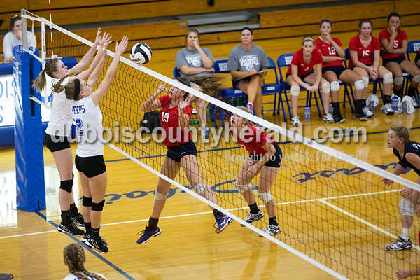 Northeast Dubois' Adi Denu, left, and Clare Mangin jumped to block a shot during Tuesday's volleyball match in Dubois. Northeast Dubois defeated South Knox in 3 sets. Sarah Ann Jump/The Herald