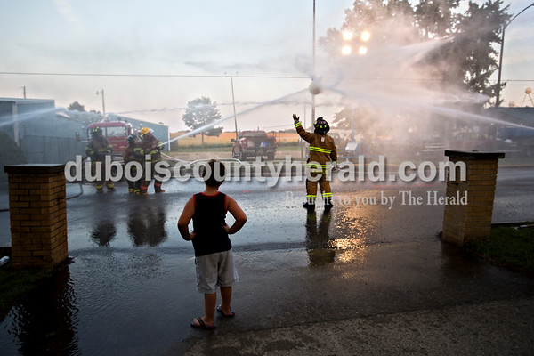 Carson Gayhart of Winslow, 6, watched the Pike County firefighters compete during the waterball tournament at Herbstfest on Friday night in Huntingburg.  Alisha Jucevic/The Herald