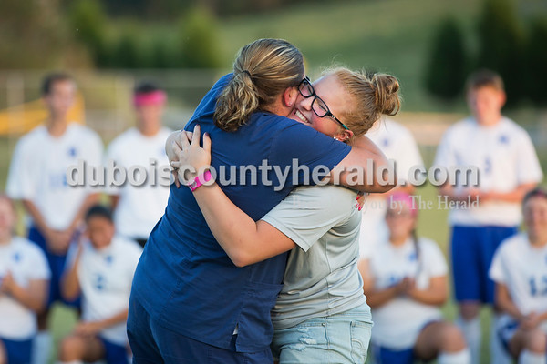 Student manager and senior Harlee Zehr hugged her mother Cathy Zehr of Haysville during senior night following Thursday evening's game in Dubois. Northeast Dubois defeated Southridge 4-3. Sarah Ann Jump/The Herald