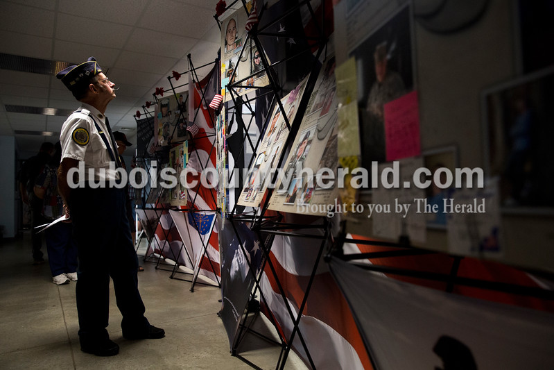 Sarah Ann Jump/The Herald<br /> American Legion Post 343 veteran Richard Mangel of Holland viewed the Remembering Our Fallen touring photo display at the Jasper National Guard Armory on Wednesday. The display will be in Jasper through Sunday, Sept. 25.