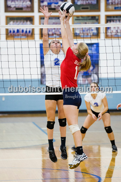 Northeast Dubois' Clare Mangin blocked a shot by South Knox's Emily Maxwell during Tuesday's volleyball match in Dubois. Northeast Dubois defeated South Knox in 3 sets. Sarah Ann Jump/The Herald