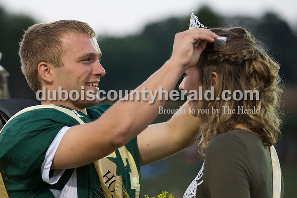 Forest Park homecoming king senior Klint Luebbehusen crowned homecoming queen senior Kendra Schipp before Friday evening's game in Ferdinand. North Posey defeated Forest Park 34-0. Sarah Ann Jump/The Herald