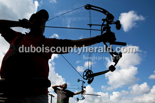 """Russell Kruer of Edwardsville, foreground, and Steve Fuller of Princeton practiced shooting their compound bows during the 3D target shoot hosted by Patoka Lake Bowhunters at Patoka Lake Archery Range on Sunday, Sept. 18. """"This is the best shoot anywhere in Indiana,"""" said Kruer, who traveled over 50 miles to attend."""
