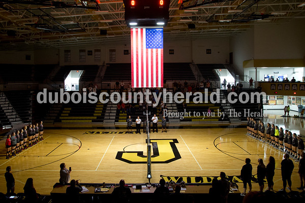 Sarah Shaw/The Herald The Southridge and Jasper girls volleyball teams stood for the national anthem before the start of the game in Jasper on Thursday. Jasper won 3-0.